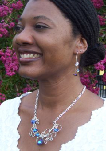 Woman Wearing Necklace and Earrings